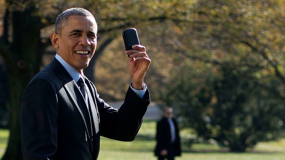 US President Obama showing off his Blackberry in 2009